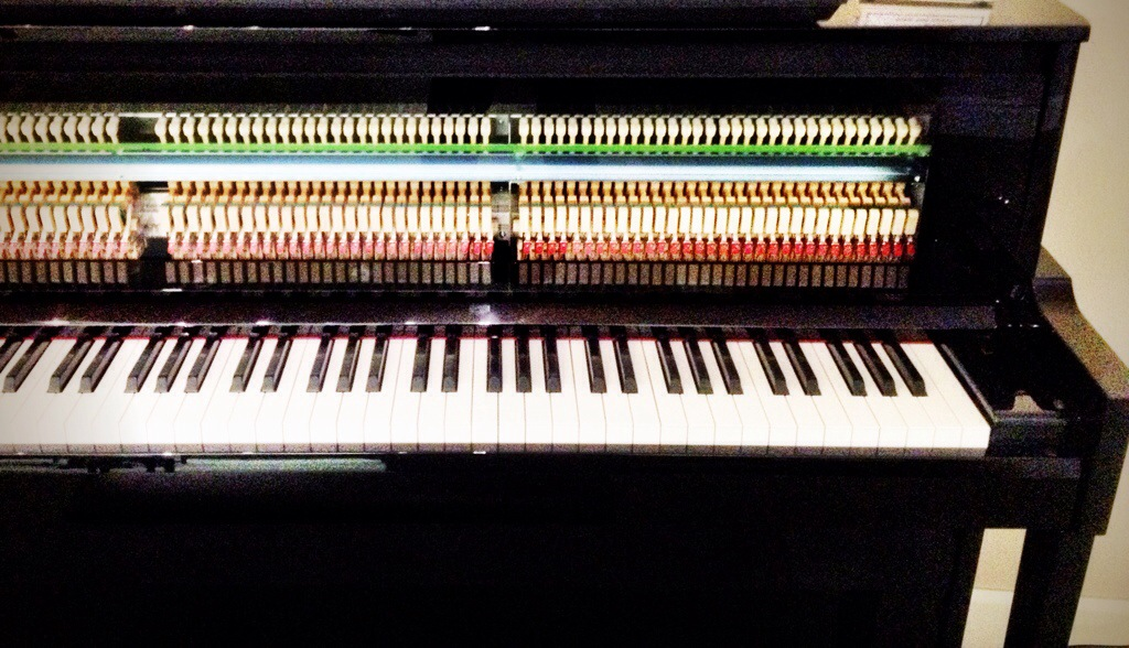 Glass-fronted demonstration Yamaha NU1 at Oakland's Piedmont Piano